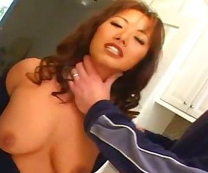 Big-titted Asian takes 2 dicks